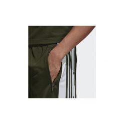 Spodnie treningowe adidas  Spodnie dresowe Adibreak. Zielone spodnie dresowe męskie Adidas, z dresówki. Za 329,00 zł.
