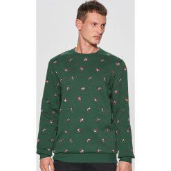 Świąteczna bluza z nadrukiem all over - Zielony. Czerwone bluzy męskie rozpinane marki KALENJI, m, z elastanu, z długim rękawem, długie. Za 89,99 zł.