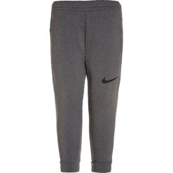 Nike Performance DRIFIT  Spodnie treningowe dark steel grey heather. Szare spodnie dresowe dziewczęce Nike Performance, z elastanu. W wyprzedaży za 139,30 zł.