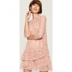 Koronkowa sukienka - Różowy. Różowe sukienki koronkowe marki numoco, l, z dekoltem w łódkę, oversize. Za 79,99 zł.
