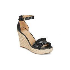 Sandały MICHAEL Michael Kors  BELLA WEDGE. Czarne sandały trekkingowe damskie marki MICHAEL Michael Kors, z gumy, przed kolano, na wysokim obcasie. Za 699,00 zł.