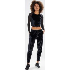 Puma EXPLOSIVE  Bluzka z długim rękawem puma black. Czarne topy sportowe damskie Puma, s, z elastanu, sportowe, z długim rękawem. W wyprzedaży za 183,20 zł.