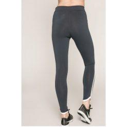 Nike Sportswear - Legginsy. Szare legginsy Nike Sportswear, l, z bawełny. W wyprzedaży za 139,90 zł.