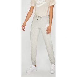 Nike Sportswear - Spodnie. Szare bryczesy damskie Nike Sportswear, l, z bawełny. W wyprzedaży za 179,90 zł.