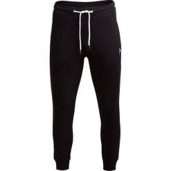 Spodnie dresowe męskie SPMD601 - CZARNY - Outhorn. Czarne spodnie dresowe męskie Outhorn, na jesień, z bawełny. W wyprzedaży za 55,99 zł.