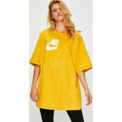 Nike Sportswear - Top. Różowe topy damskie marki Nike Sportswear, l, z nylonu, z okrągłym kołnierzem. Za 199,90 zł.
