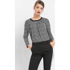 Koszulka w kwiaty. Czarne bluzki longsleeves marki Orsay, xs, w kwiaty, z dzianiny, z okrągłym kołnierzem. W wyprzedaży za 55,00 zł.