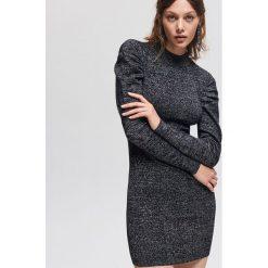 Błyszcząca sukienka - Czarny. Białe sukienki marki Reserved, l, z dzianiny. Za 99,99 zł.