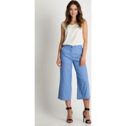 Paski damskie: Szerokie spodnie w paski BIALCON