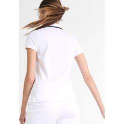 Polo Ralph Lauren Golf Koszulka polo pure white. Białe topy sportowe damskie Polo Ralph Lauren Golf, s, z bawełny. W wyprzedaży za 279,30 zł.
