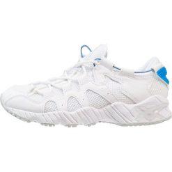 Asics Tiger GELMAI Tenisówki i Trampki white. Białe tenisówki damskie Asics Tiger, z materiału. W wyprzedaży za 384,30 zł.