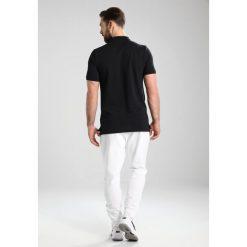 Nike Performance HERITAGE  Koszulka polo black/black. Czarne koszulki polo marki Nike Performance, m, z bawełny. Za 179,00 zł.