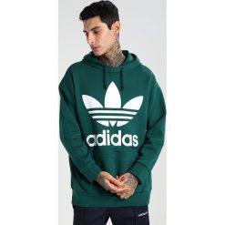 Adidas Originals ADICOLOR TREF OVER Bluza z kapturem green. Szare bluzy męskie rozpinane marki adidas Originals, na co dzień, z nadrukiem, z bawełny, casualowe, z okrągłym kołnierzem, proste. Za 379,00 zł.