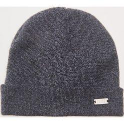 Czapka - Granatowy. Czarne czapki zimowe męskie marki KIPSTA, z poliesteru, do piłki nożnej. Za 25,99 zł.