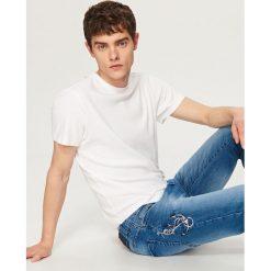 Rurki męskie: Jeansy z motywem kotwicy slim fit - Niebieski