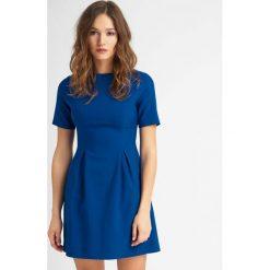 Sukienki hiszpanki: Rozkloszowana sukienka mini