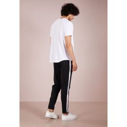 Polo Ralph Lauren INTERLOCK Spodnie treningowe black. Czarne spodnie dresowe męskie Polo Ralph Lauren, z bawełny. Za 459,00 zł.
