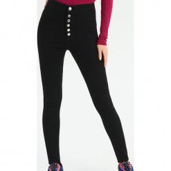 Jeansy super skinny z wysokim stanem - Czarny. Czarne spodnie z wysokim stanem marki Sinsay, z jeansu. Za 59,99 zł.