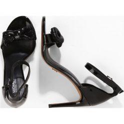 MICHAEL Michael Kors PARIS SANDAL Sandały na obcasie black. Czarne sandały damskie marki MICHAEL Michael Kors, z gumy, przed kolano, na wysokim obcasie. W wyprzedaży za 480,35 zł.