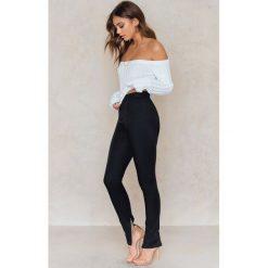 Spodnie z wysokim stanem: Vanessa Moe x NA-KD Spodnie garniturowe – Black