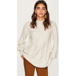 Sweter z niską stójką - Jasny szar. Niebieskie swetry klasyczne damskie marki ARTENGO, z elastanu, ze stójką. Za 79,99 zł.