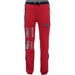 """Spodnie dresowe """"Mindwiller"""" w kolorze czerwonym. Czerwone joggery męskie Geographical Norway, z aplikacjami, z dresówki. W wyprzedaży za 117,95 zł."""