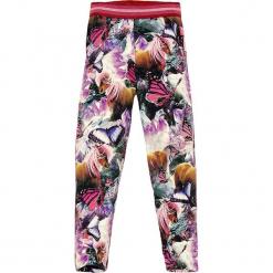 Legginsy z kolorowym wzorem. Niebieskie legginsy dziewczęce marki KIPSTA, z elastanu. W wyprzedaży za 49,95 zł.