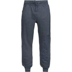 Lonsdale London Logo Large Spodnie dresowe odcienie granatowego. Szare joggery męskie marki Lonsdale London, z nadrukiem, z dresówki. Za 62,90 zł.