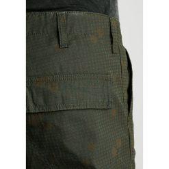 Bojówki męskie: Carhartt WIP REGULAR COLUMBIA Bojówki camo night/combat green