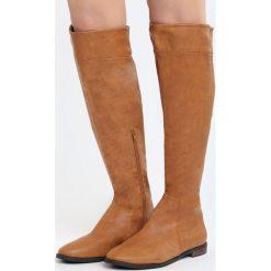 Camelowe Kozaki Luck Be A Lady. Pomarańczowe buty zimowe damskie marki Born2be, na płaskiej podeszwie. Za 139,99 zł.