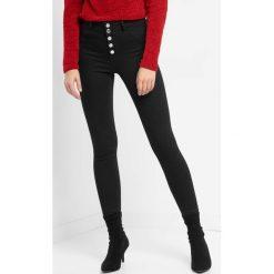 Jegginsy z wysokim stanem. Czarne legginsy marki Orsay, xs, z bawełny, z dekoltem na plecach. Za 99,99 zł.