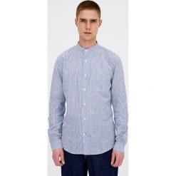 Koszula ze stójką z organicznej bawełny i lnu. Białe koszule męskie na spinki Pull&Bear, m, z bawełny, ze stójką. Za 89,90 zł.