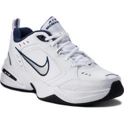 Buty NIKE - Air Monarch IV 415445 102 White/Metallic Silver. Białe buty fitness męskie Nike, z materiału. W wyprzedaży za 199,00 zł.