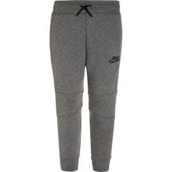 Nike Performance TECH PANT Spodnie treningowe carbon heather/anthracite. Czarne spodnie chłopięce marki Nike Performance, l, z materiału, outdoorowe. W wyprzedaży za 254,15 zł.