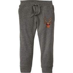 Bożonarodzeniowe spodnie dresowe bonprix szary melanż z nadrukiem. Czarne spodnie dresowe chłopięce marki bonprix, w paski. Za 24,99 zł.