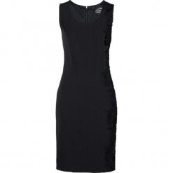 Sukienka shape z koronką bonprix czarny. Czarne sukienki koronkowe marki bonprix, w koronkowe wzory, dopasowane. Za 124,99 zł.