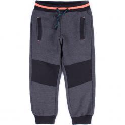 Spodnie. Szare chinosy chłopięce NOISE, z bawełny. Za 49,90 zł.