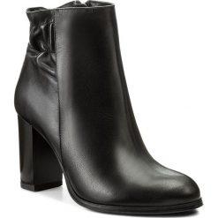 Botki KOTYL - 9707 Czarny Lico. Czarne buty zimowe damskie Kotyl, ze skóry, na obcasie. W wyprzedaży za 299,00 zł.