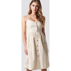 MANGO Sukienka Salvia - Beige. Szare sukienki z falbanami marki Mango, na co dzień, l, z tkaniny, casualowe, z dekoltem halter, na ramiączkach, midi, rozkloszowane. Za 141,95 zł.