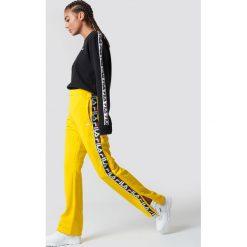 Spodnie damskie: FILA Spodnie Thora Track - Yellow