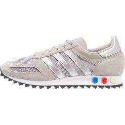 Adidas Originals LA TRAINER Tenisówki i Trampki solid grey/metallic silver/footwear white. Szare tenisówki damskie marki adidas Originals, z materiału. W wyprzedaży za 359,20 zł.