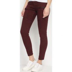 Rurki damskie: Bordowe Spodnie Ferity