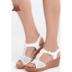 Białe Skórzane Sandały Firevorks Factory. Białe sandały damskie marki Born2be, z materiału, na koturnie. Za 99,99 zł.