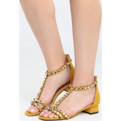 Żółte Sandały Shrewdness. Żółte sandały damskie marki Born2be, z materiału, na wysokim obcasie, na obcasie. Za 69,99 zł.