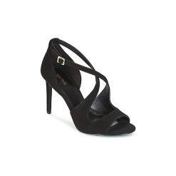 Sandały MICHAEL Michael Kors  ESTEE. Czarne sandały damskie marki MICHAEL Michael Kors, z gumy, przed kolano, na wysokim obcasie. Za 659,00 zł.