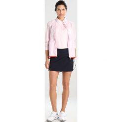 J.LINDEBERG DENA Koszulka sportowa soft pink. Czerwone topy sportowe damskie J.LINDEBERG, xl, z materiału, polo. Za 299,00 zł.