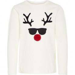 """Koszulka """"Rasto"""" w kolorze białym. Białe t-shirty chłopięce z długim rękawem Name it Kids, z aplikacjami, z bawełny. W wyprzedaży za 37,95 zł."""