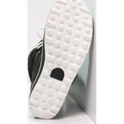 Sorel GLACY EXPLORER Śniegowce black. Czarne buty zimowe damskie marki Sorel, z materiału. Za 659,00 zł.