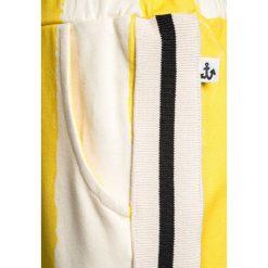 Noé & Zoë SPORTY PANTS Spodnie treningowe yellow. Żółte spodnie chłopięce Noé & Zoë, z bawełny. Za 249,00 zł.