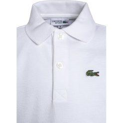 Lacoste Sport TENNIS Koszulka polo white. Białe t-shirty chłopięce Lacoste Sport, z bawełny. W wyprzedaży za 175,20 zł.